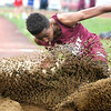 Woodrow Wilson's Kelshawn Grant makes a sandy landing as he competes in the long jump during the Beckley Relays Tuesday evening.<br /> Brad Davis/The Register-Herald