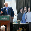 Greenbrier Resort owner Jim Justice speaks to the crowd Tuesday afternoon in front of cardboard cutouts of the band Maroon 5, right, and singer-singwriter Jimmy Buffett, left, as he announces that the artists will perform at this year's Greenbrier Classic Concert Series in White Sulphur Springs.<br /> Brad Davis/The Register-Herald
