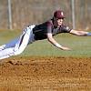 Flying Eagles' second baseman Brandon Chandler dives for a sharply hit ground ball against James Monroe Monday evening at Woodrow Wilson High.<br /> Brad Davis/The Register-Herald