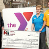 Raleigh General CEO David Darden, left, presents a sponsorship check of $2500 for the YMCA International Dinner to the YMCA's Reginia Thomas, center, and Jay Rist, right, during a Wednesday afternoon press conference. F. Brian Ferguson/The Register-Herald