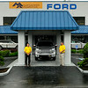 Brad Davis/The Register-Herald  <br /> Mountaineer Automotive owners Donnie Holcomb, right, and Keith Tyler pose for a quick photo outside of their dealership at the old Ramey Ford location on Eisenhower Drive July 28.