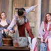 Brad Davis/The Register-Herald  <br /> (From left) Allifair, played by Haley Hizer, Phamer, played by Nick Yurick, and Roseanne McCoy, played by Allie Patton, perform during a scene from Theatre West Virginia's Hatfields and McCoys July 25 at Grandview Park's Cliffside Amphitheatre.