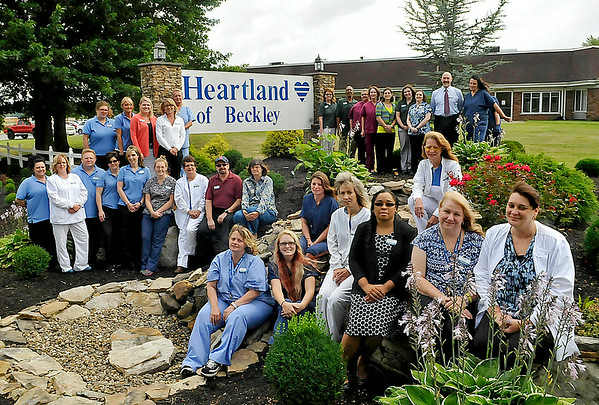 Brad Davis/The Register-Herald <br /> The staff of Heartland of Beckley gathers for a group photo July 28 outside their location off Dry Hill Road.
