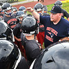 Rick Barbero/The Register-Herald<br /> Chris Vicars, head football coach at Independence High School, speak with his team about how to properly take care of there helments during practice Wednesday morning at the High School.