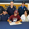 Shady Spring standout athlete Jordan Meadows signs a letter of intent to play baseball at Concord University surrounded by coaches and family Monday afternoon in the Tigers' gymnasium. Joining him at the table are his little brothers Jason (far right) and Jacob (far left), his parents Sheila and Scotty (left of Jordan), Shady Spring Athletic Director Steve Clark (back row middle) and baseball coaches Darrell Frasier (back row left) and James Sears (back row right).<br /> Brad Davis/The Register-Herald