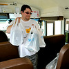 Brad Davis/The Register-Herald<br /> Volunteer Thomas Wallace brings in another load of school supplies onto a school bus parked outside of the Beckley Walmart Saturday afternoon during Concord University Beckley's Stuff the Bus school supply drive. The goal was to fill every seat on a Raleigh County school bus with as much donated school supplies as possible, which the volunteers on hand easily achieved thanks generous shoppers.