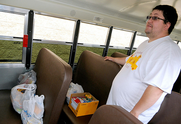 Brad Davis/The Register-Herald<br /> Volunteer Thomas Wallace waits for another load of school supplies on a school bus parked outside of the Beckley Walmart Saturday afternoon during Concord University Beckley's Stuff the Bus school supply drive. The goal was to fill every seat on a Raleigh County school bus with as much donated school supplies as possible, which the volunteers on hand easily achieved thanks generous shoppers.