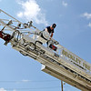 Brad Davis/The Register-Herald   <br /> Beckley firefighter first class Chris Lanna performs a routine maintenance check high atop Ladder #1 Monday morning in front of Park Middle School. Mondays are the day fire departments throughout the area test and check their equipment for any repairs that might be needed. Station #1, located on 3rd Avenue, brought a couple of their trucks to Park Middle where they'd have some space to extend the massive ladder to make sure it works properly.