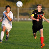 Brad Davis/The Register-Herald<br /> Oak Hill striker Ian Hunt races to a forwarded ball with Shady Spring's Joel Scarbro during the Red Devils' win over the Tigers Thursday evening at the YMCA Paul Cline Memorial Sports Complex.