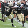 Curtis Lofton, left, tries to bring down Mark Ingram, during the New Orleans Saints scrimmage Saturday morning at The Grenbrier Resort.<br /> Rick BArbero/The Register-Herald