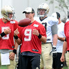 Longan Kilgore, left, Drew Brees and Ryan Griffin, all quarterback take a break during the New Orleans Saints practice Tuesday morning at The Greenbrier Resort.<br /> Rick Barbero/The Register-Herald