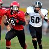 Brad Davis/The Register-Herald<br /> Liberty's Christian Whittaker carries the ball against Westside Friday night in Glen Daniel.
