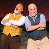 Brad Davis/The Register-Herald<br /> (From left) Rand'l McCoy, played by Dan Henthorn, and Devil Anse Hatfield, played by Andy Woodruff, sing a friendly song together during a scene from Theatre West Virginia's Hatfields and McCoys July 25 at Grandview Park's Cliffside Amphitheatre.