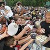 Jimmy Graham signs autographs after the New Orleans Saints scrimmage Saturday morning at The Grenbrier Resort.<br /> Rick Barbero/The Register-Herald