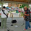 """Brad Davis/The Register-Herald <br /> Chaz Humley and the Effects lead singer Jim """"Daffy"""" Spence, right, looks back at his drummer as he and his bandmates jam out Saturday evening during the Simply Jazz and Blues Festival."""