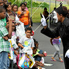 Brad Davis/The Register-Herald  <br /> Mime Donnella Swieny (right) performs ministry through dance as she interacts with onlookers during Heart of God Ministries' back to school event Saturday afternoon at the church's South Kanawha Street location. The church handed out school supplies to area children and put on numerous entertainment activities.