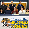 Shady Spring standout athlete Jordan Meadows signed a letter of intent to play baseball at Concord University surrounded by coaches and family Monday afternoon in the Tigers' gymnasium. Joining him at the table are his little brothers Jason (far right) and Jacob (far left), his parents Sheila and Scotty (left of Jordan), Shady Spring Athletic Director Steve Clark (back row middle) and baseball coaches Darrell Frasier (back row left) and James Sears (back row right).<br /> Brad Davis/The Register-Herald