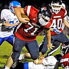 Brad Davis/The Register-Herald <br /> Independence defensive lineman Tyler Green rumbles ahead after scooping a loose ball that was initially fumbled by Midland Trail quarterback Tristan White Friday night in Coal City.