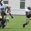 Mark Ingram breaks away for a big gain during the New Orleans Saints scrimmage Saturday morning at The Grenbrier Resort.<br /> Rick BArbero/The Register-Herald
