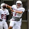 Brad Davis/The Register-Herald<br /> Woodrow Wilson senior quarterback Brent Osborne runs plays during preseason practice August 11.