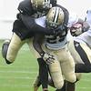 Rafael Bush, tackles Patrick Robinson during the New Orleans Saints scrimmage Saturday morning at The Grenbrier Resort.<br /> Rick BArbero/The Register-Herald