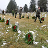 Brad Davis/The Register-Herald<br /> Members of the West Virginia Civil Air Patrol's Beckley Composite Squadron place wreaths on the graves of every service member buried at the American Legion Cemetery off South Kanawha Street following a ceremony Saturday morning. The event was part of Wreaths Across America's nationwide effort to honor and remember the country's fallen service men and women with a holiday wreath. Mountaineer Automotive Group, The Beckley Moose Lodge and the Beckley Mountaineer Auto Mall donated funds for the 189 wreaths laid Saturday.