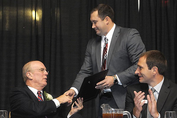 Rick Barbero/The Register-Herald<br /> Charlie Houck, left, recieves was presnted a letter from YMCA of the USA form D.F. Mock, during the Spirit of Beckley Community Service Award Banquet held at the Beckley-Raleigh County Convention Center Monday night.