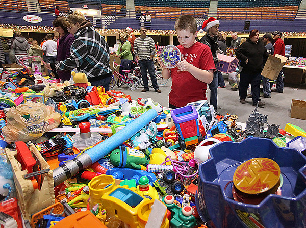 Brad Davis/The Register-Herald<br /> Young volunteer Will Chouinard can't help himself as he takes a quick break to gawk at some of the interesting toys available during Mac's Toy Fund Party Saturday morning at the Beckley-Raleigh County Convention Center.