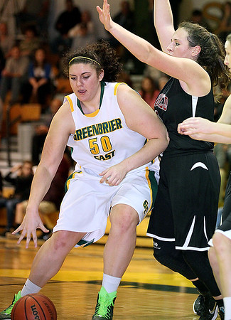 Brad Davis/The Register-Herald<br /> Greenbrier East's Sydney Nunley drives as Bluefield's Jia Coppola defends during the Spartans' win over the Beavers in the first ever Jerry Bradley Memorial Tournament Saturday night in Fairlea.