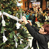 Rick Barbero/The Register-Herald<br /> Hospice of Southern West Virginia celebrated the season with their annual Angel Tree Ceremony Monday at Crossroads Mall.Debi Benton, of Fayetteville, placed an angel ornament in memory of her mother.