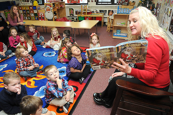 Rick Barbero/The Register-Herald<br /> Marybeth Garcia reads The Night Before Christmas Nosed Reindeer during a Christmas celebration to her Pre-K class at Crescent Elementay School in Beckley Thursday afternoon.