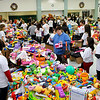 Brad Davis/The Register-Herald<br /> Hundreds pack Wyoming East High School Sunday morning during this year's Wyoming County Toy Fund Sunday morning.