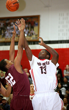 Brad Davis/The Register-Herald<br /> Oak Hill's Joseph Curry plays during a game against Woodrow Wilson December 12.