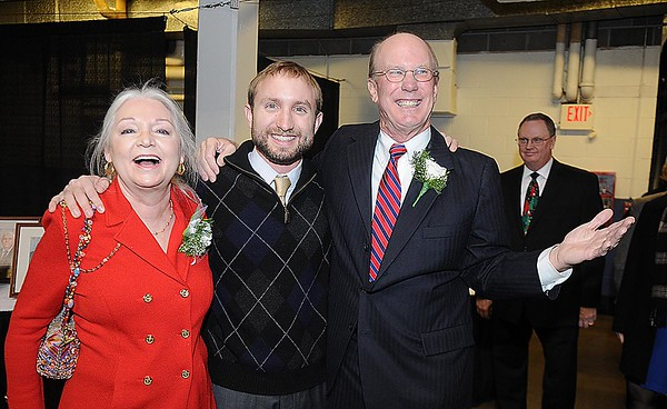 Rick Barbero/The Register-Herald<br /> Charlie Houck, left, with his wife Terri and son Cutter Houck, during the Spirit of Beckley Community Service Award Banquet held at the Beckley-RAleigh County Convention Center Monday night.