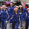Brad Davis/The Register-Herald<br /> Students from Karen's Academy of Dance keep the smiles flowing despite the rain Saturday afternoon.