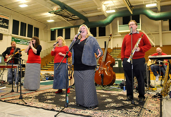 Brad Davis/The Register-Herald<br /> The Stewart Family band entertains the masses in the Wyoming East High School gymnasium during this year's Wyoming County Toy Fund Sunday morning.