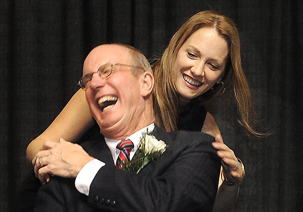 Rick Barbero/The Register-Herald<br /> Lindsey Flanagan, co-chair,  Charlie Houck, just before she read a speech from president Obama during the Spirit of Beckley Community Service Award Banquet held at the Beckley-Raleigh County Convention Center Monday night.