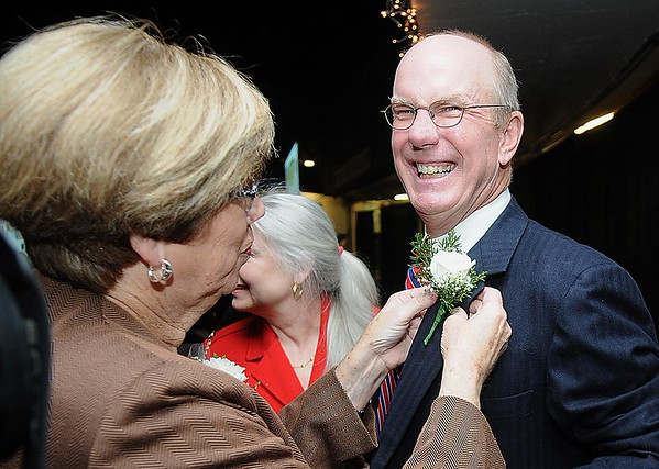 Rick Barbero/The Register-Herald<br /> Susan Landis, left, pins a flower on Charlie Houck, during the Spirit of Beckley Community Service Award Banquet held at the Beckley-RAleigh County Convention Center Monday night.