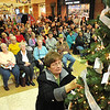 Rick Barbero/The Register-Herald<br /> Hospice of Southern West Virginia celebrated the season with their annual Angel Tree Ceremony Monday at Crossroads Mall. Fern Evans, of Beaver, places angel ornaments on the tree in memory of her husband and son.
