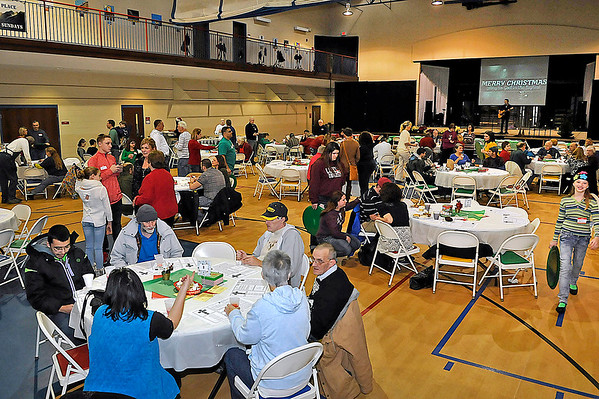 Brad Davis/The Register-Herald<br /> Hundreds of area residents came out to The Place on Christmas day for United Methodist Temple's community Christmas dinner Thursday afternoon.