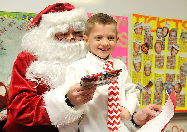 Rick Barbero/The Register-Herald<br /> Bryce Taylor, gets excited after receiving a present from Santa Claus during a Christmas celebration in Marybeth Garcia's Pre-K class at Crescent Elementay School in Beckley Thursday afternoon.
