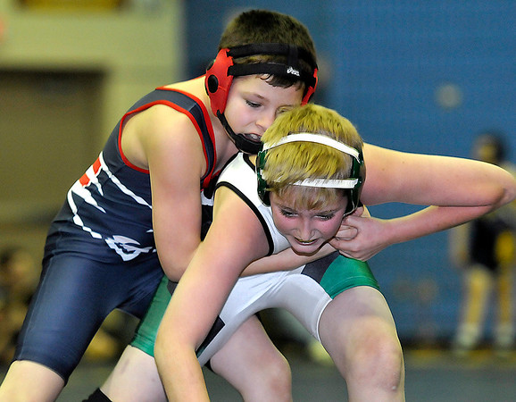 Brad Davis/The Register-Herald<br /> Fayetteville's Noah Wendell, right, takes on Independence's Jaydon Mitchem in a 102-pound weight class match during the Shady Spring Middle School Duals December 27. Indy's Mitchem went on to pin Wendell to win the match.