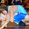 Brad Davis/The Register-Herald<br /> Western Greenbrier Middle's Zack McClung battles Elkview Middle's Nick Grayam in a 128-pound weight class matchup during the Woodrow Wilson Middle School Duals Saturday afternoon. Elkview's Grayam would go on to win the match.