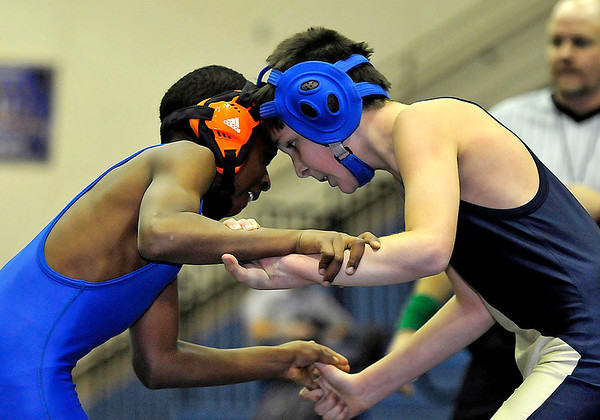 Brad Davis/The Register-Herald<br /> Shady Spring's Miles Kauffman, right, takes on Beckley-Stratton's Tauvea Davis in an 84-pound weight class match during the Shady Spring Middle School Duals Saturday morning. Davis would pin Kauffman to win the match.