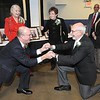 Rick Barbero/The Register-Herald<br /> Charlie Houck, left, and Jerry Rose bow down to each other during the Spirit of Beckley Community Service Award Banquet held at the Beckley-Raleigh County Convention Center Monday night.