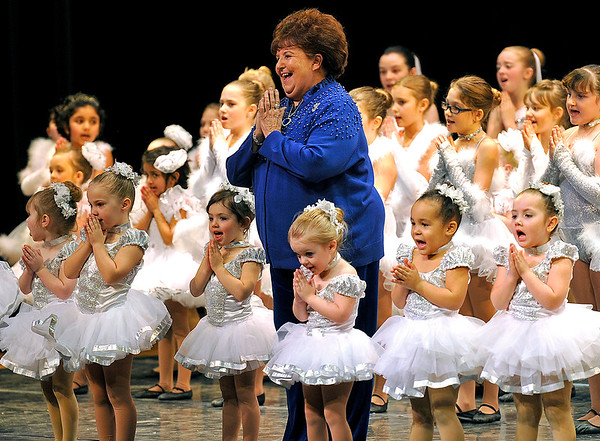"""Brad Davis/The Register-Herald<br /> Karen Fama, director, choreographer and teacher at Karen's Academy of Dance, takes the stage and sings with her students during the finale of """"No Ordinary Night,"""" the company's winter recital Sunday evening in the Woodrow Wilson High School Auditorium."""