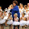 "Brad Davis/The Register-Herald<br /> Karen Fama, director, choreographer and teacher at Karen's Academy of Dance, takes the stage and sings with her students during the finale of ""No Ordinary Night,"" the company's winter recital Sunday evening in the Woodrow Wilson High School Auditorium."