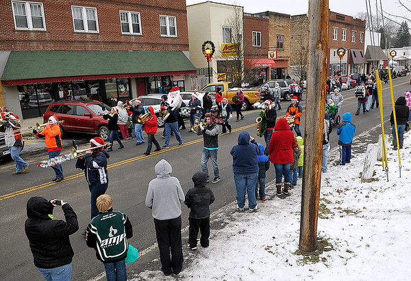 Brad Davis/The Register-Herald<br /> Area residents line the streets to watch the bands and catch some candy as the Sophia Christmas Parade makes its way down Main Street on a chilly Saturday afternoon.