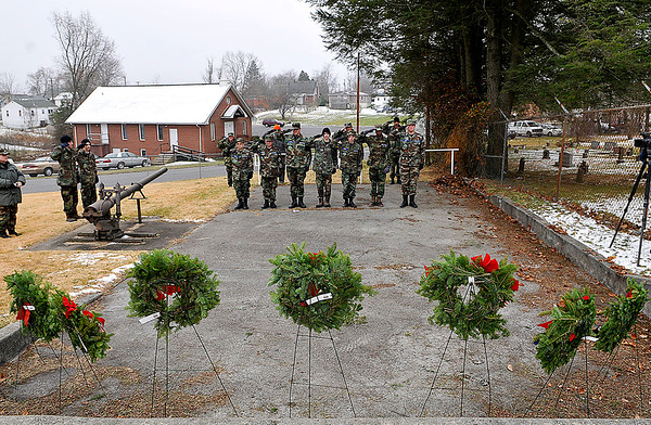 Brad Davis/The Register-Herald<br /> Members of the West Virginia Civil Air Patrol's Beckley Composite Squadron salute during a brief ceremony before placing wreaths on the graves of every service member buried at the American Legion Cemetery off South Kanawha Street Saturday morning. The event was part of Wreaths Across America's nationwide effort to honor and remember the country's fallen service men and women with a holiday wreath. Mountaineer Automotive Group, The Beckley Moose Lodge and the Beckley Mountaineer Auto Mall donated funds for the 189 wreaths laid Saturday.