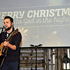 Brad Davis/The Register-Herald<br /> Musician Eric Robbins serenades the hundreds who came out to The Place with warm Christmas songs during United Methodist Temple's community Christmas dinner Thursday afternoon.